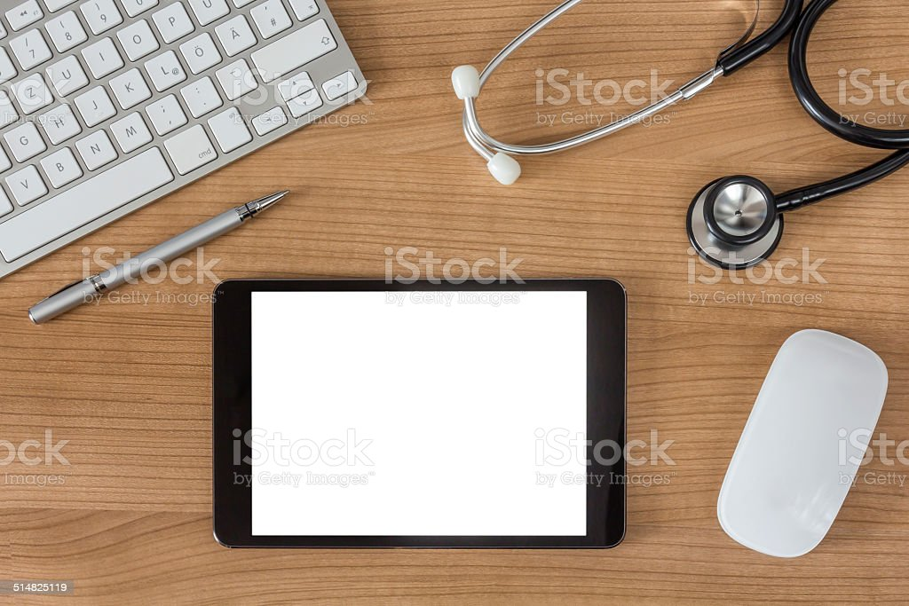 Doctors Desk with tablet computer stock photo