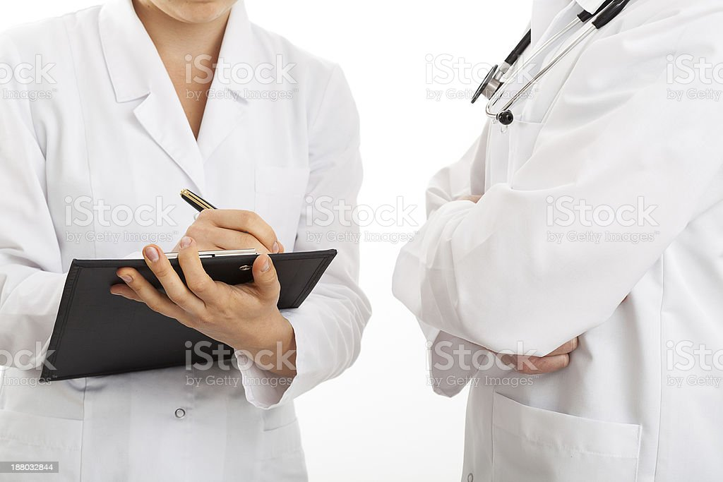 Doctors discussing and taking notes royalty-free stock photo