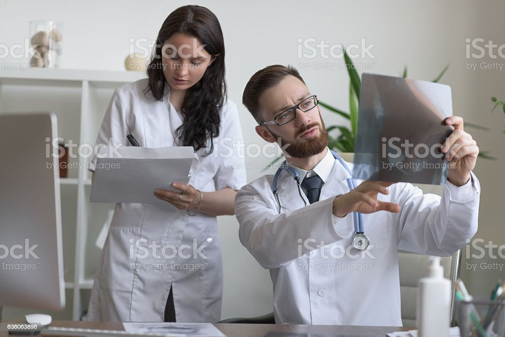 Doctors discussing intestines X-ray stock photo