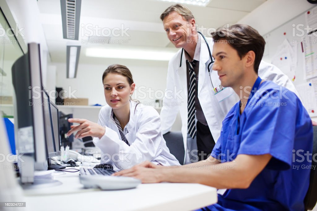 Doctors during computer tomography exam royalty-free stock photo