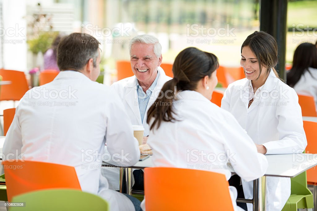 Doctors eating at the hospital's cafeteria stock photo