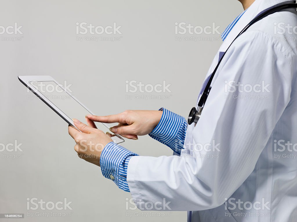 Doctors examined using the mobile tablet PC royalty-free stock photo