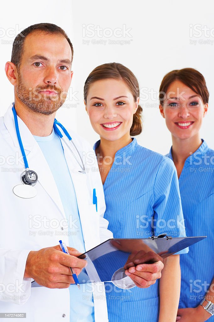 Doctors examining a report royalty-free stock photo
