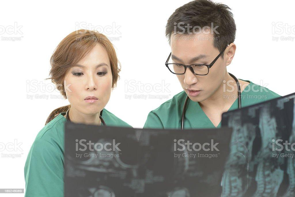 Doctors examining MRI scan royalty-free stock photo