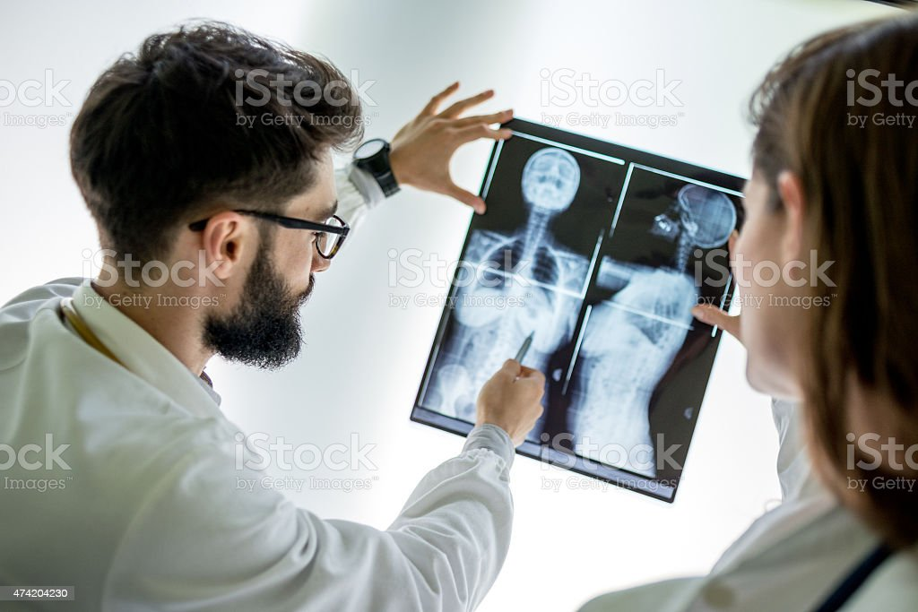 Doctors examining x-ray stock photo