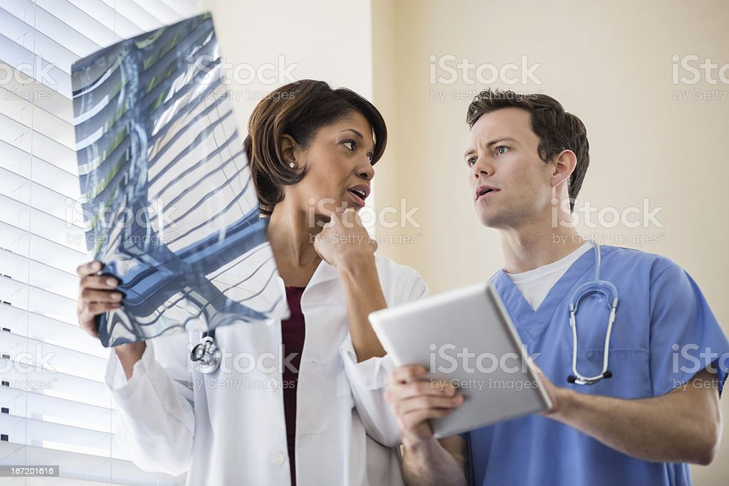 Doctors examining X-Ray report royalty-free stock photo