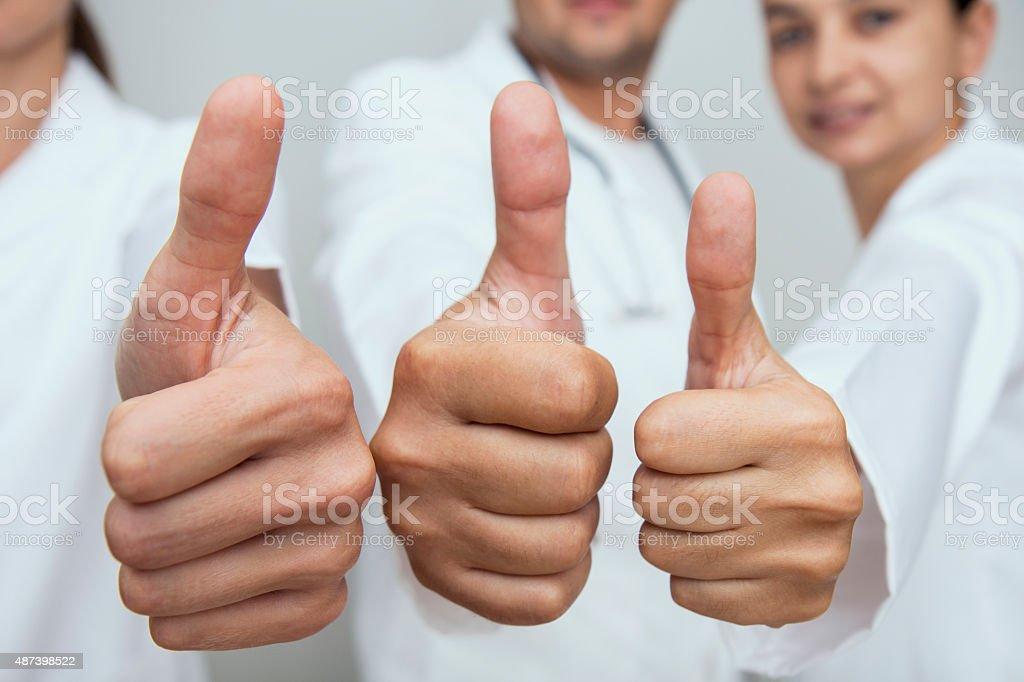 Doctors Gesturing Thumbs Up stock photo