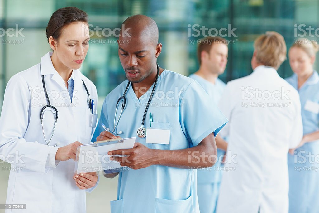 Doctors going over patient charts royalty-free stock photo
