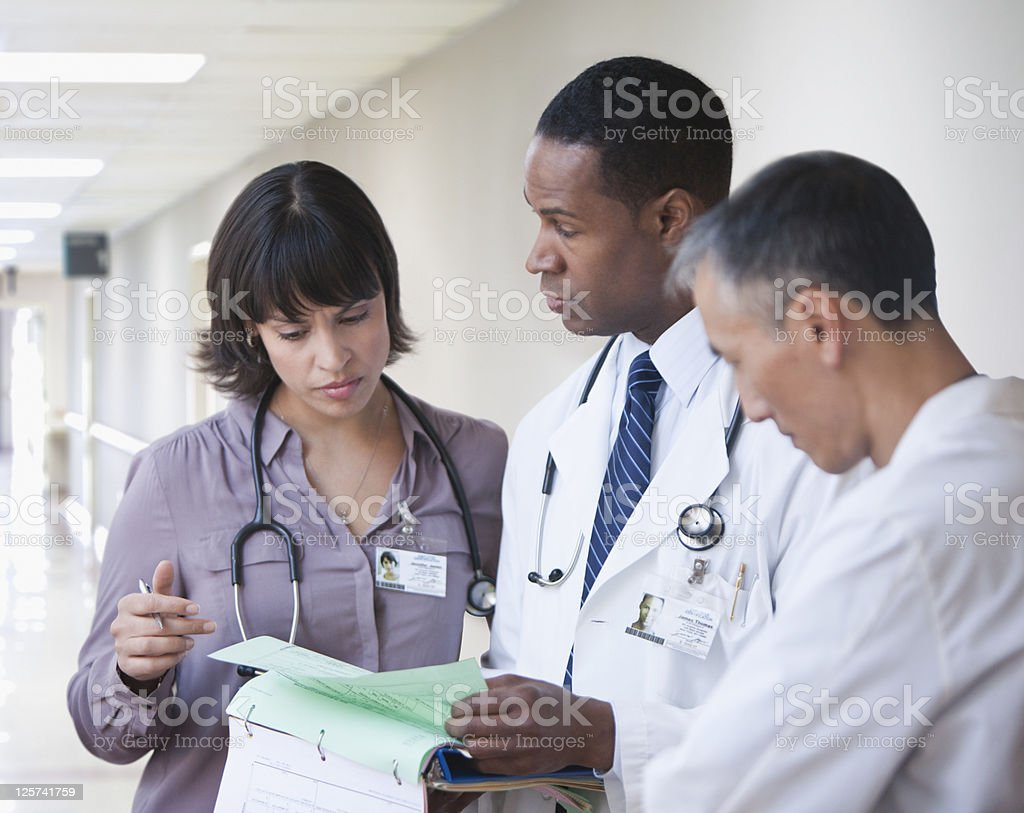 Doctors going over reports royalty-free stock photo