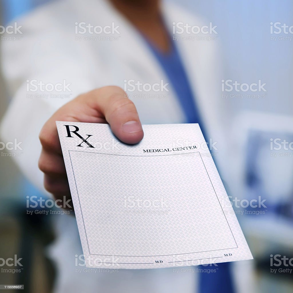 Doctor's Hand holding Prescription Pad stock photo