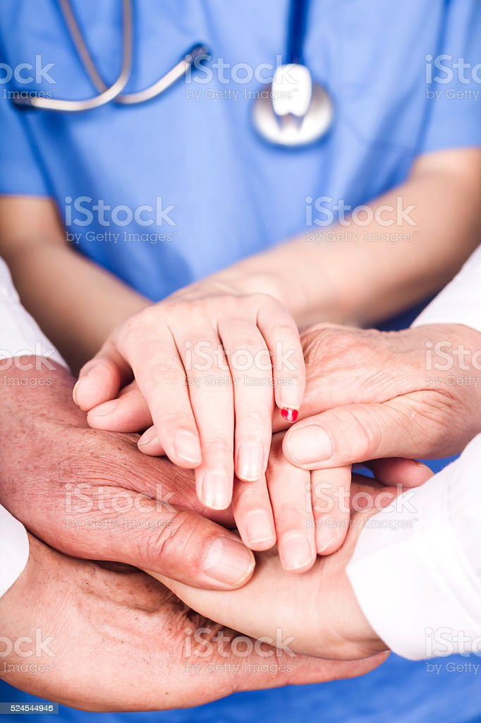 doctor`s hand touching:We are a team stock photo