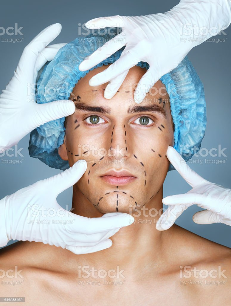 Doctor's hands in gloves touch face stock photo