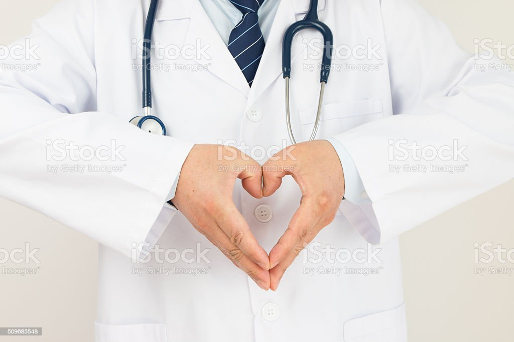 Doctors hands making heart-shaped stock photo
