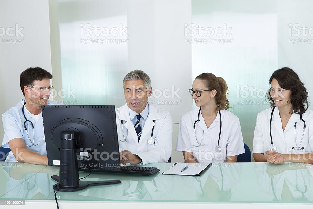 Doctors having a meeting stock photo