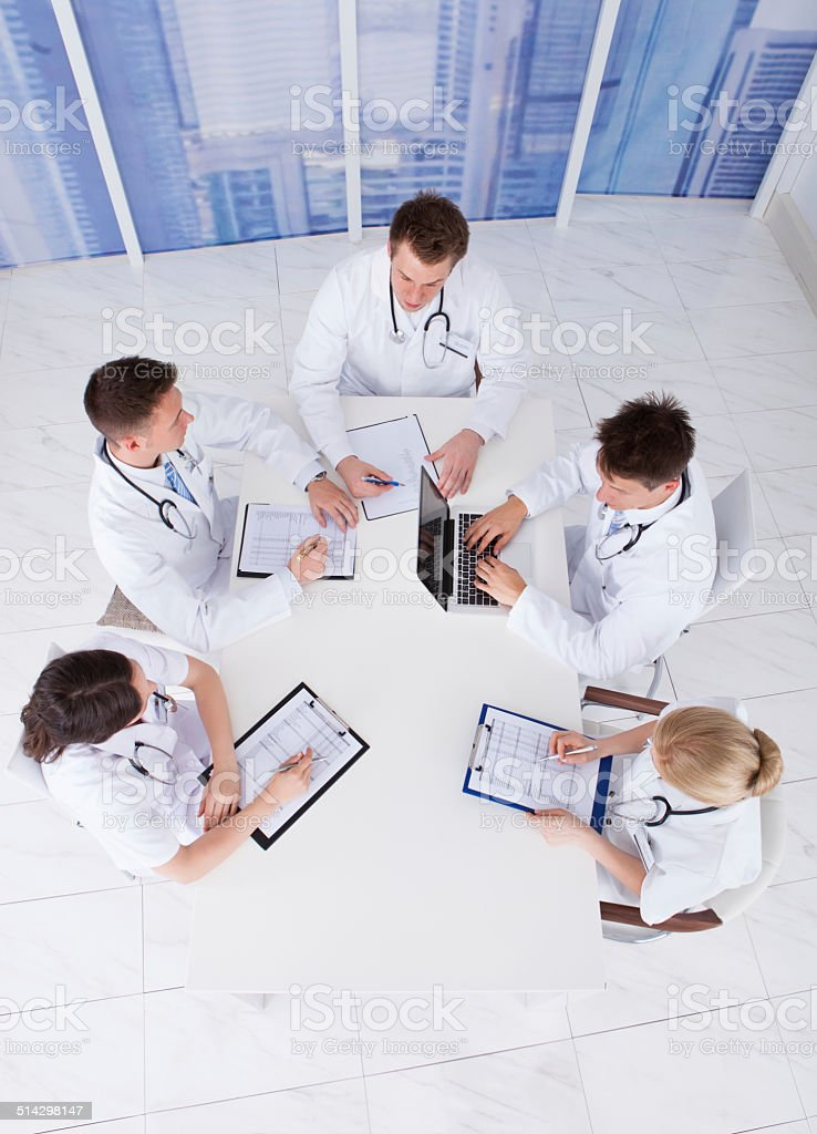 Doctors Having Conference Meeting In Hospital stock photo