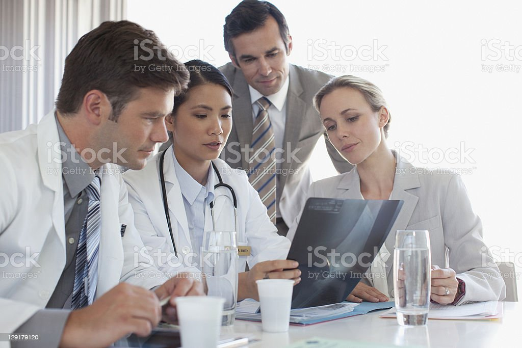 Doctors having discussion regarding X-Ray royalty-free stock photo