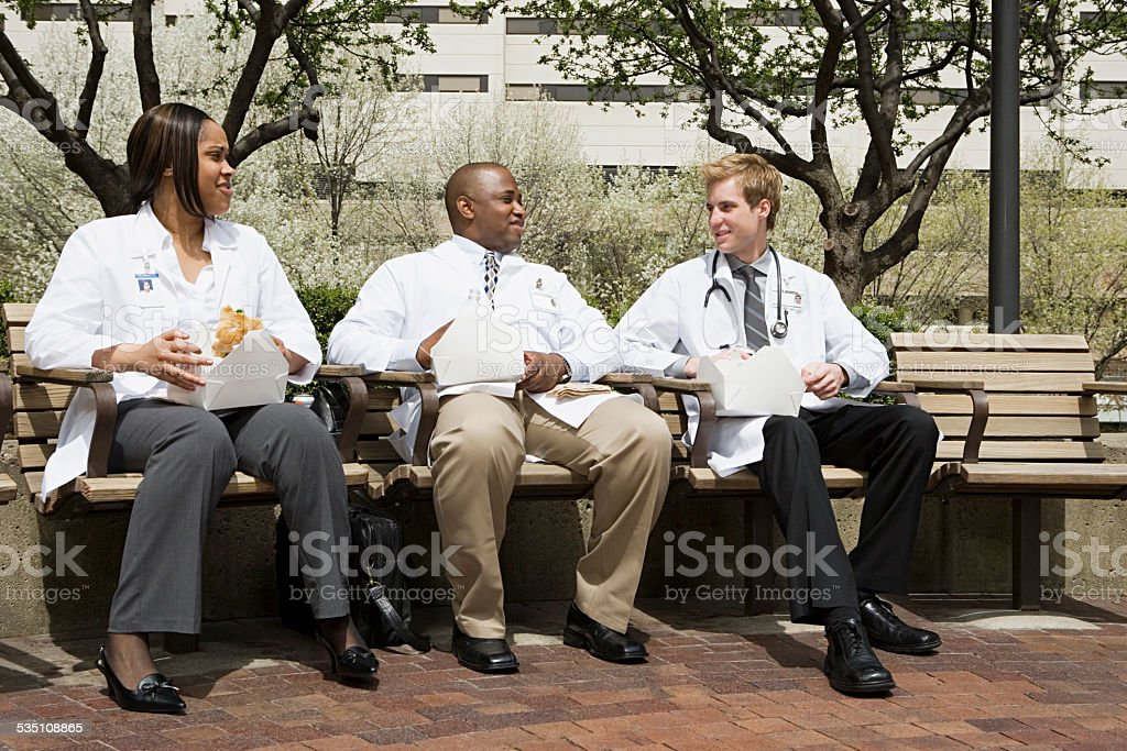Doctors having lunch stock photo