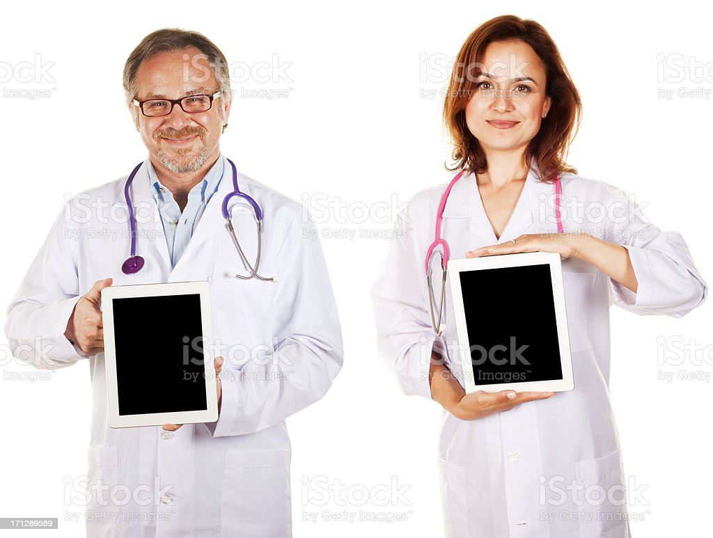 Doctors holding digital tablet royalty-free stock photo