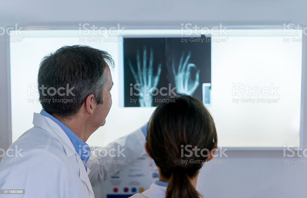 Doctors looking at a an x-ray stock photo