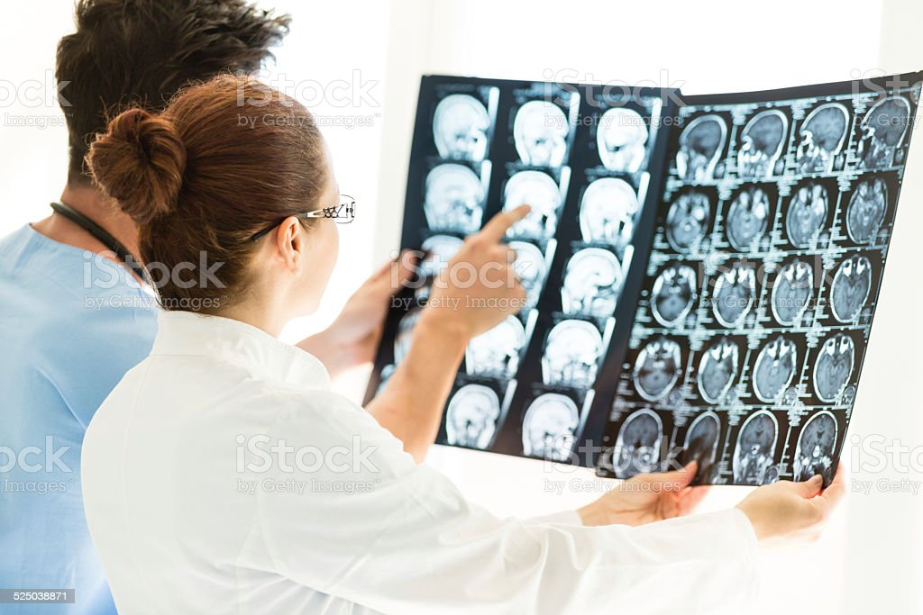 Doctors Looking At MRI Scan Of The Brain stock photo