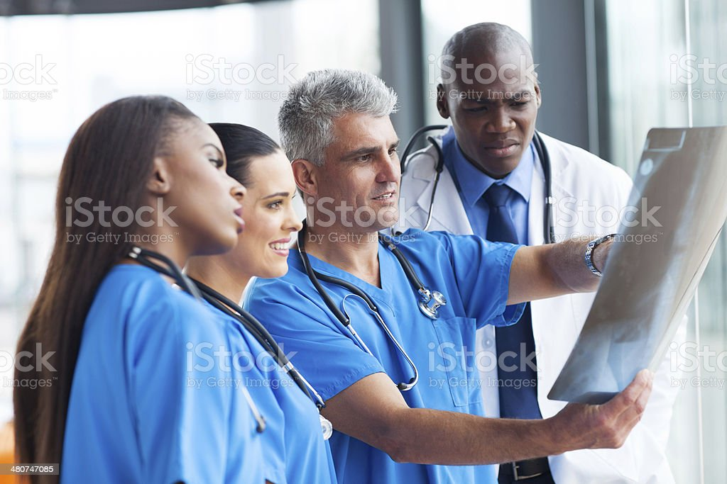 doctors looking at patient's x-ray stock photo