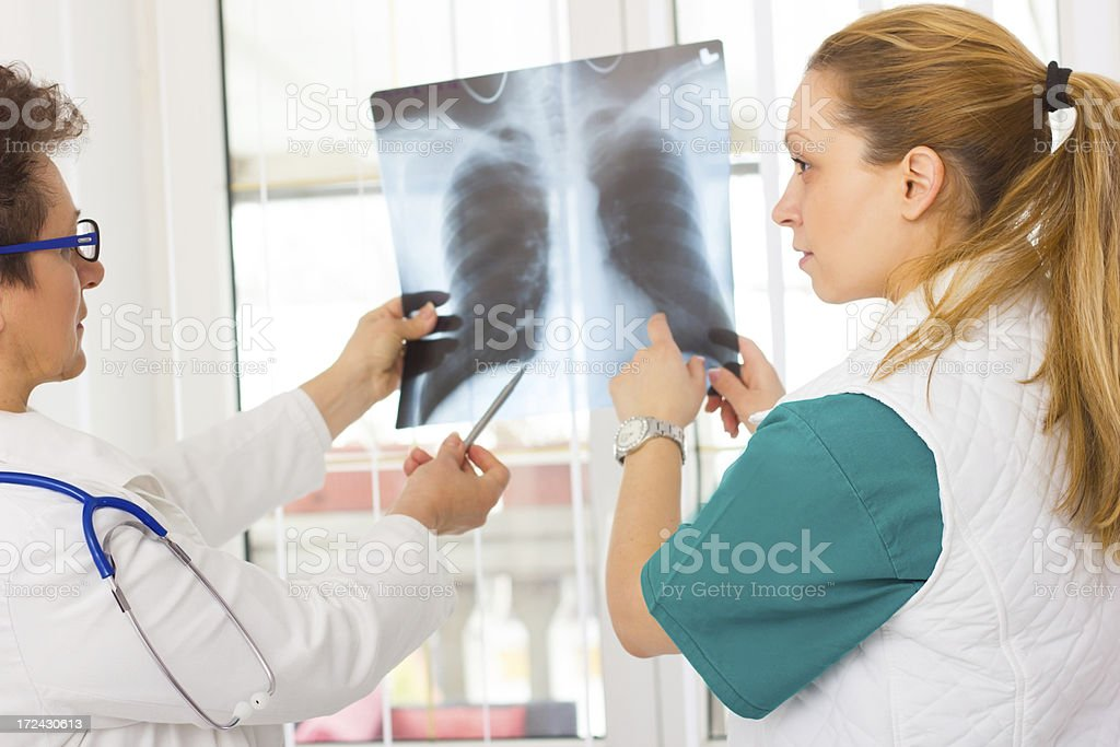 Doctors looking at x ray. royalty-free stock photo