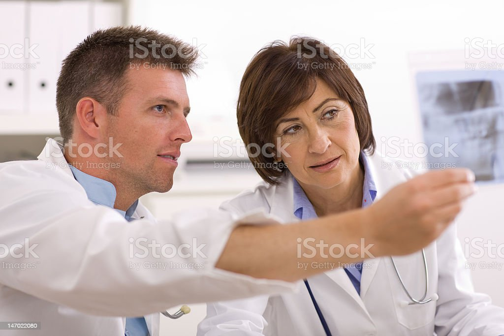 Doctors looking at x-ray image royalty-free stock photo