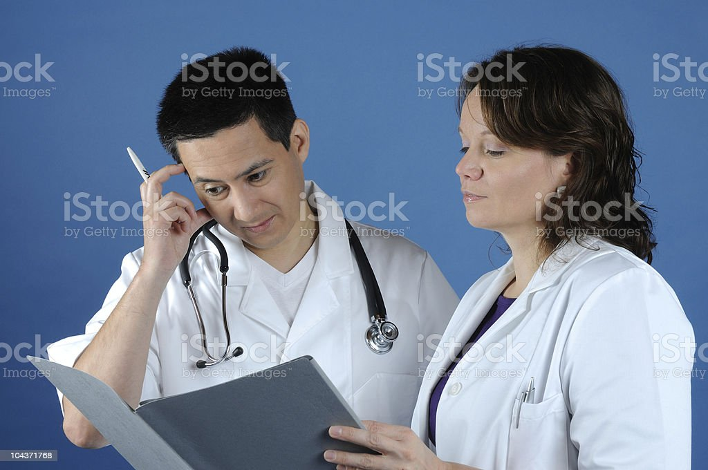 Doctors looking for Clinical Findings stock photo