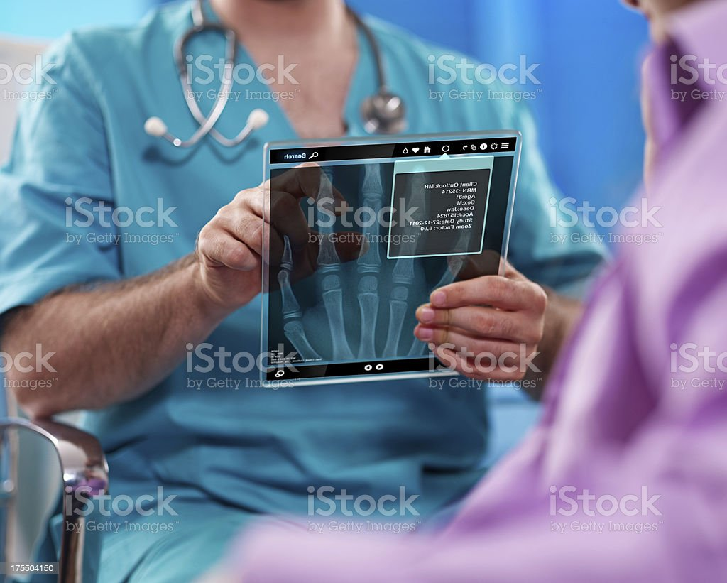 doctors looking on digital tablet stock photo