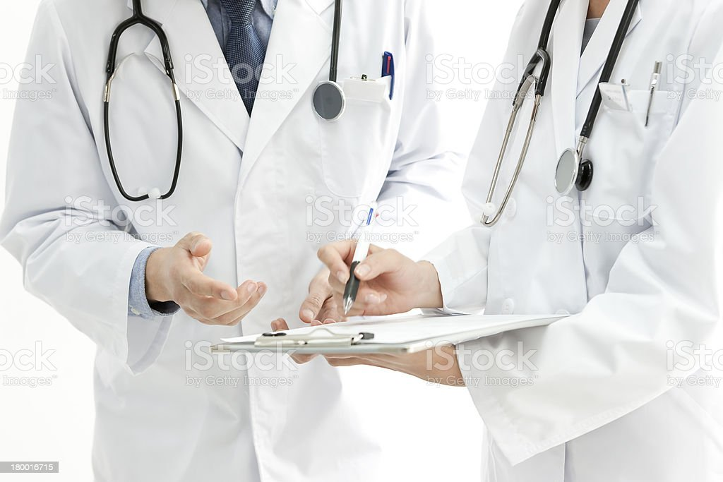 Doctors making arrangements stock photo