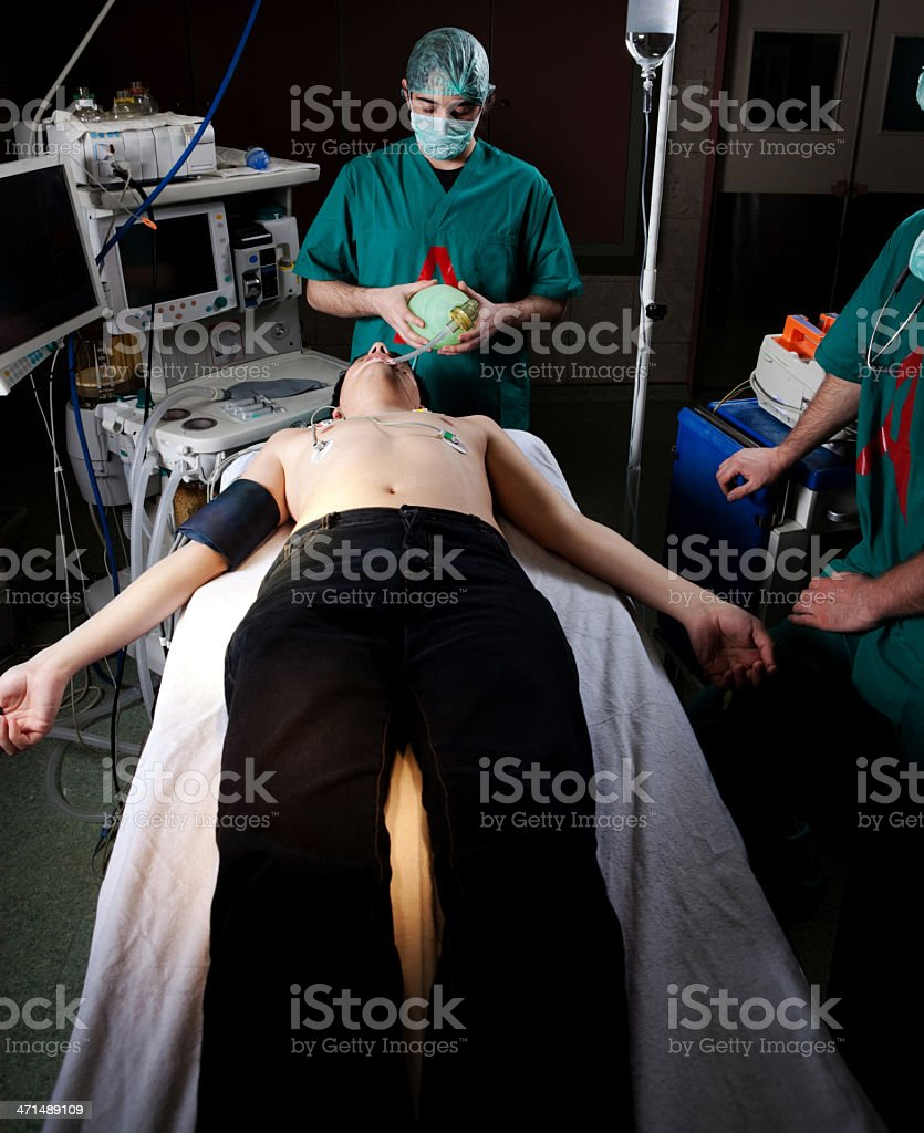 Doctors performing a serious operation royalty-free stock photo