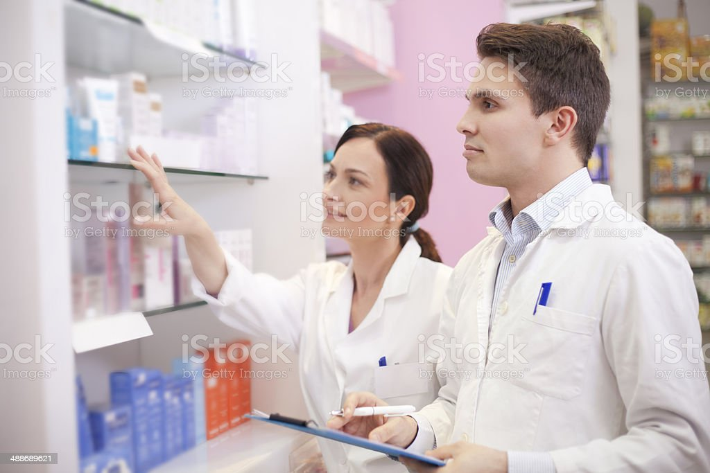Doctors pharmacists at work stock photo