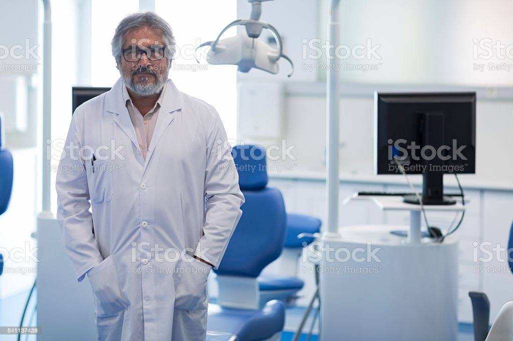 Doctor's portrait smiling and looking at camera. stock photo