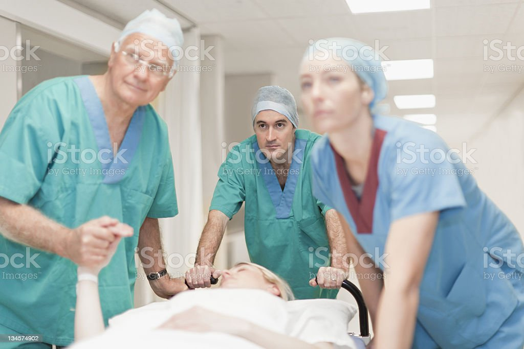 Doctors preparing patient for surgery stock photo