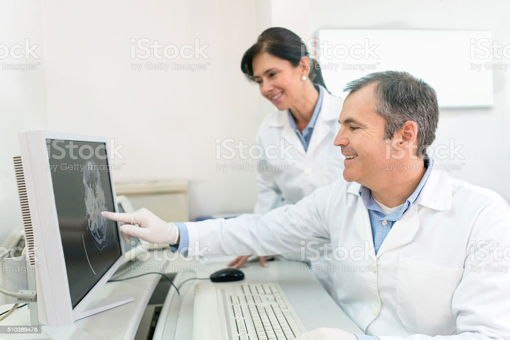 Doctors reading a CT scan stock photo