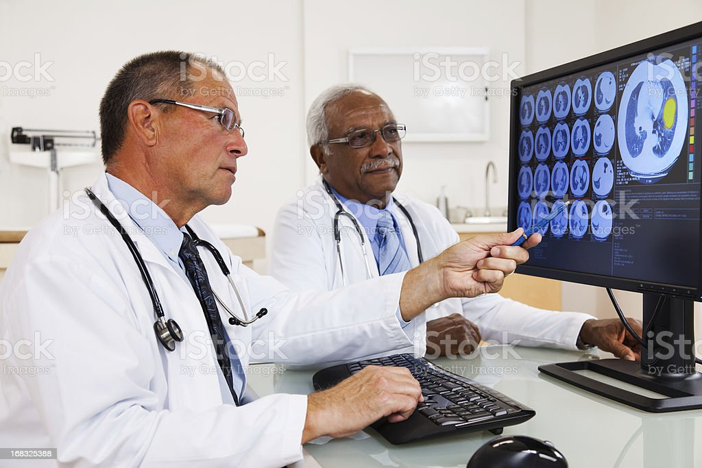 Doctors Reviewing Test Results royalty-free stock photo