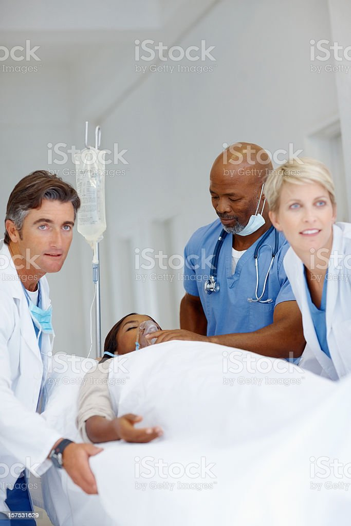 Doctors rushing with a patient on stretcher royalty-free stock photo