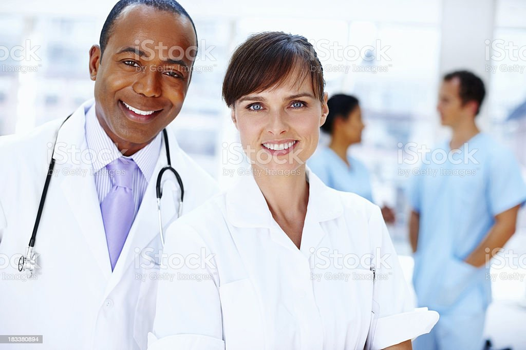 "Doctors saying ""How can we help?"" royalty-free stock photo"