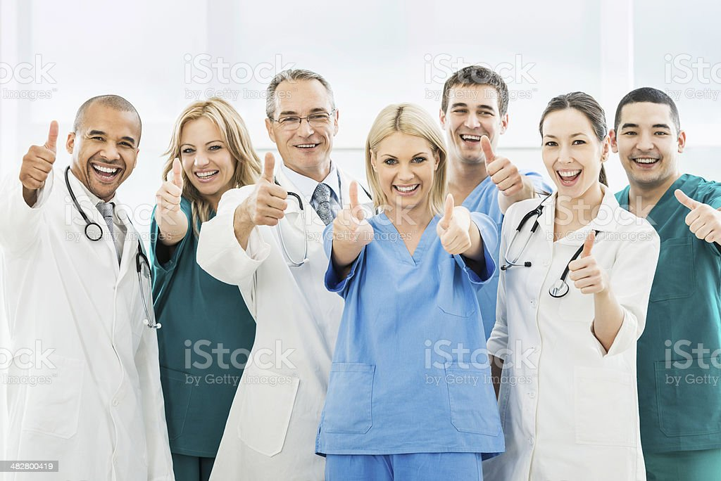 Doctors showing thumbs up. stock photo