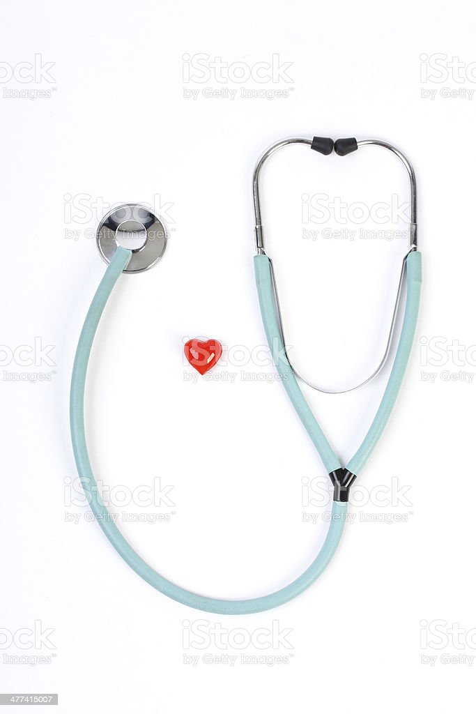 Doctors stethoscope and one small red heart on white background royalty-free stock photo