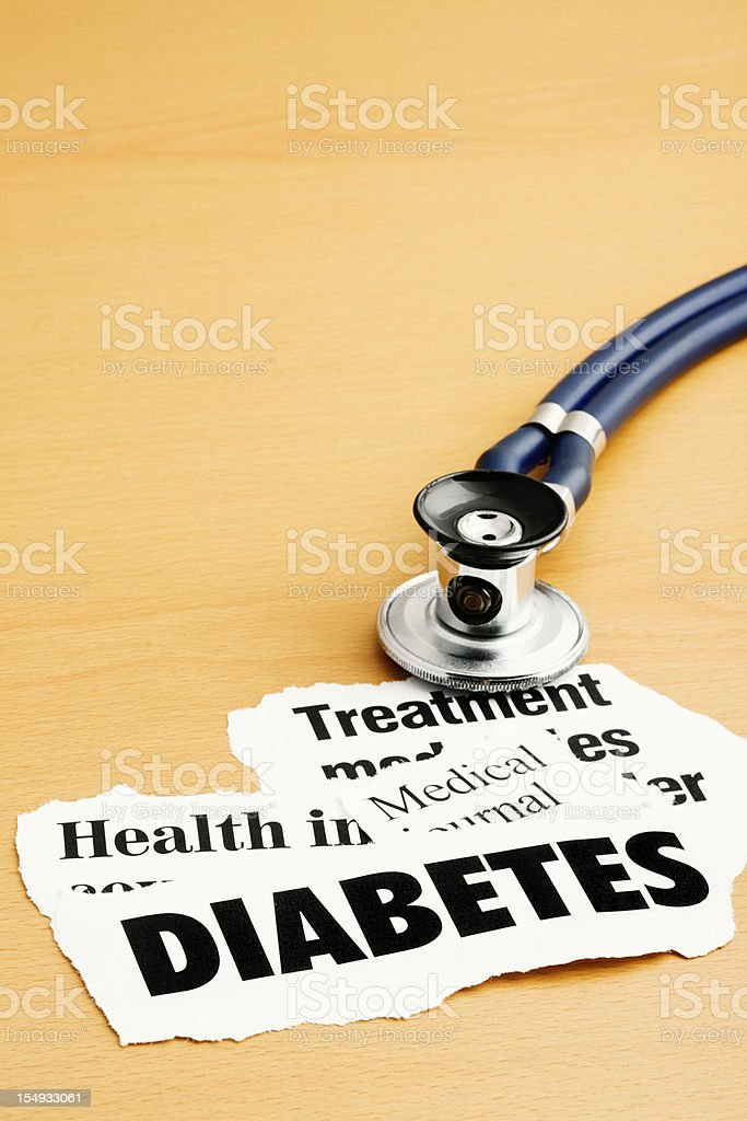 Doctor's stethoscope sits on headlines about diabetes stock photo