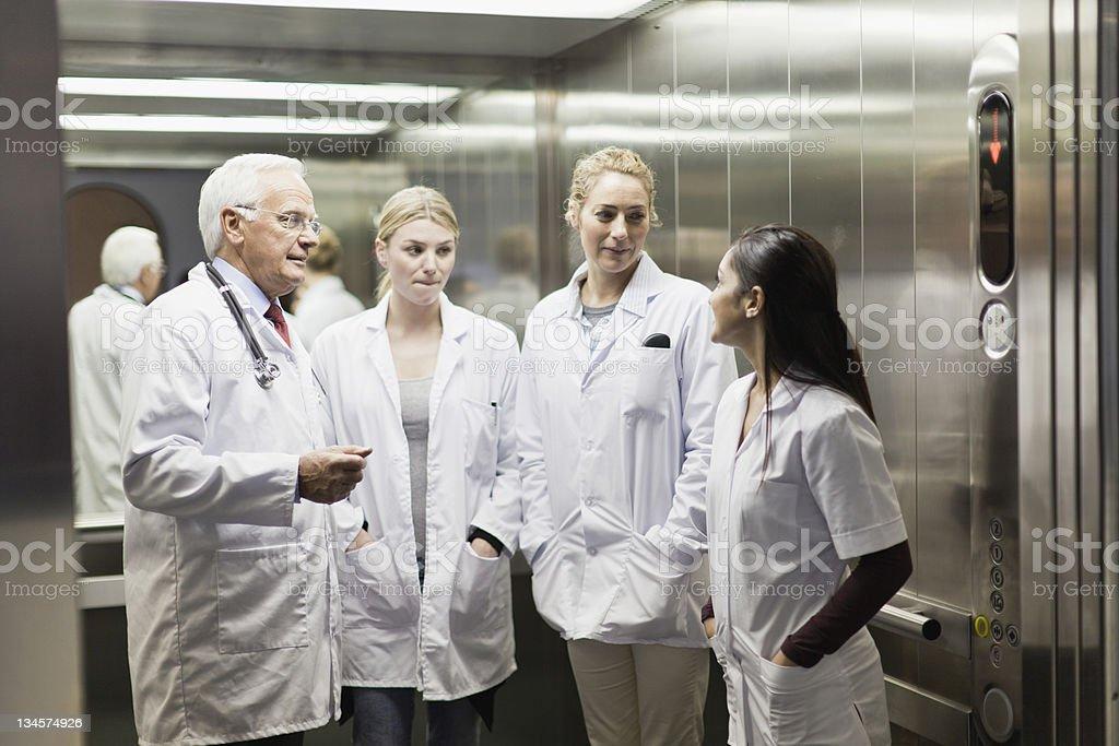 Doctors talking in hospital elevator stock photo
