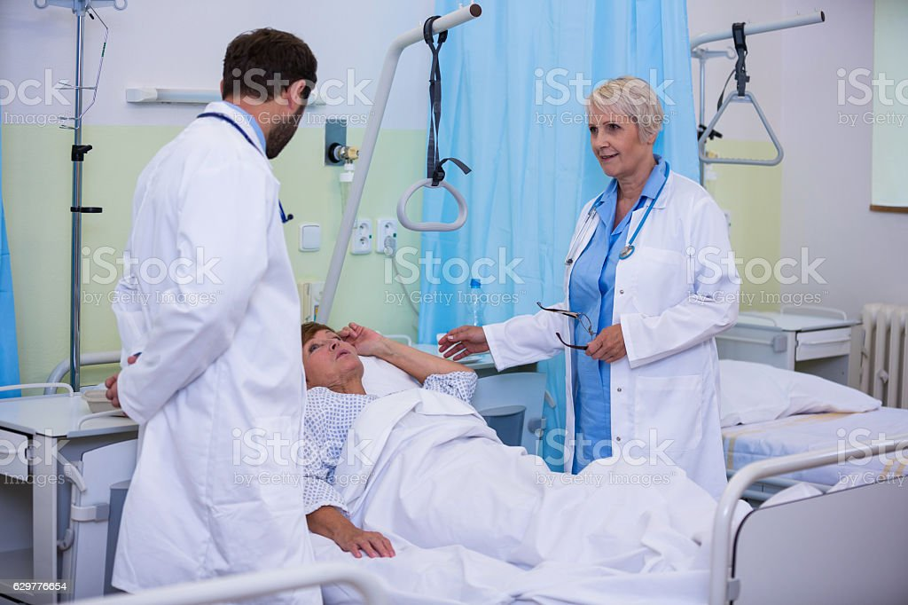 Doctors talking to a senior patient stock photo