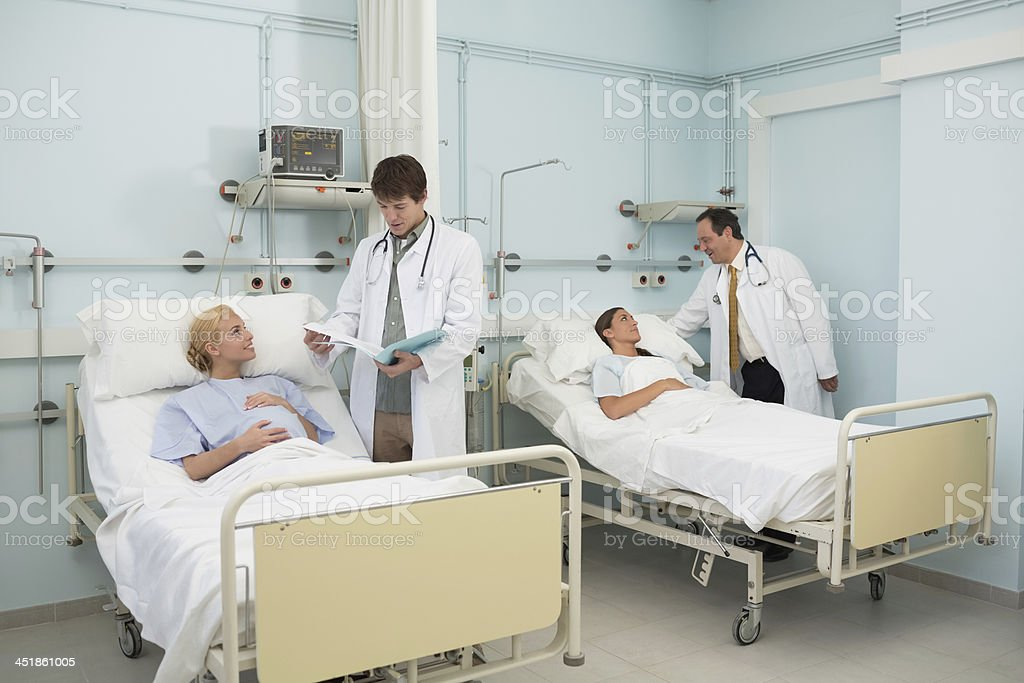 Doctors talking to women patients royalty-free stock photo