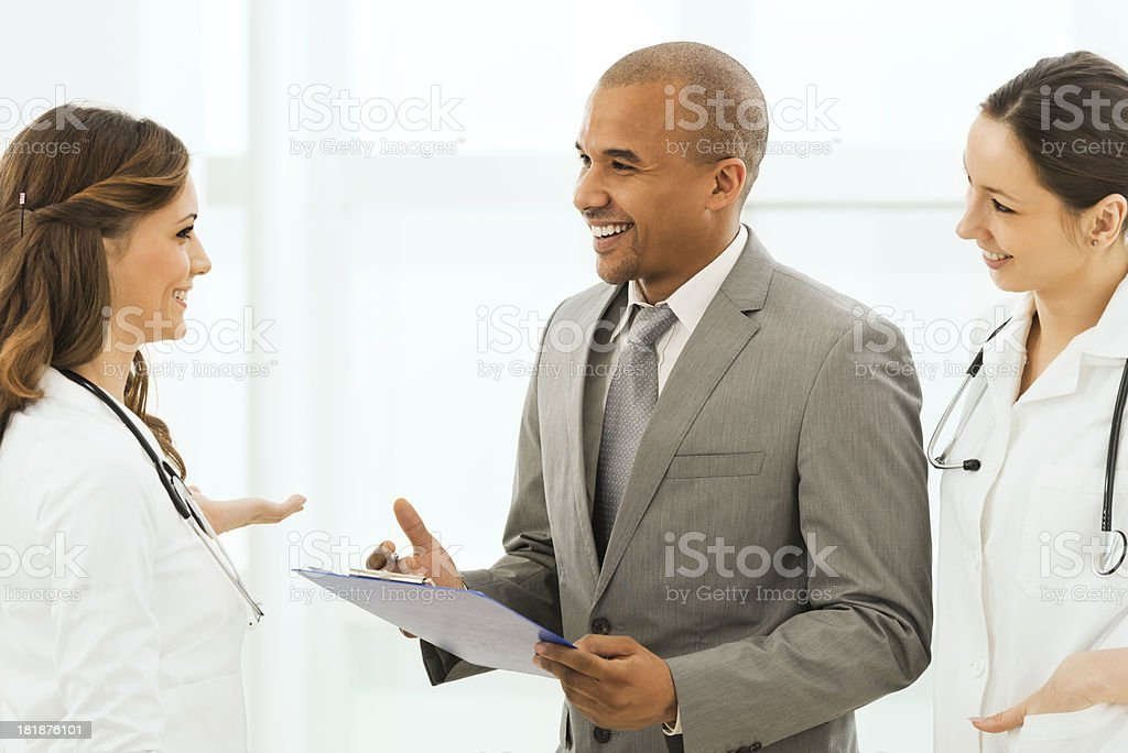 Doctors talking with a businessman. royalty-free stock photo