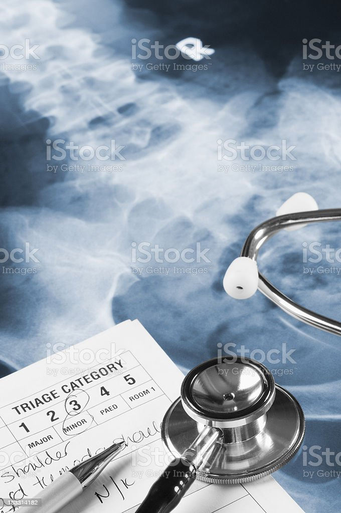 Doctors Triage Notes, stethoscope and pen on X-Ray royalty-free stock photo
