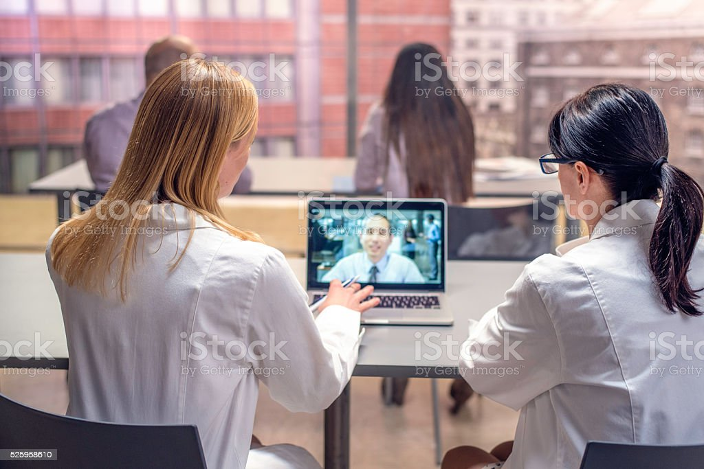 Doctors video conference stock photo