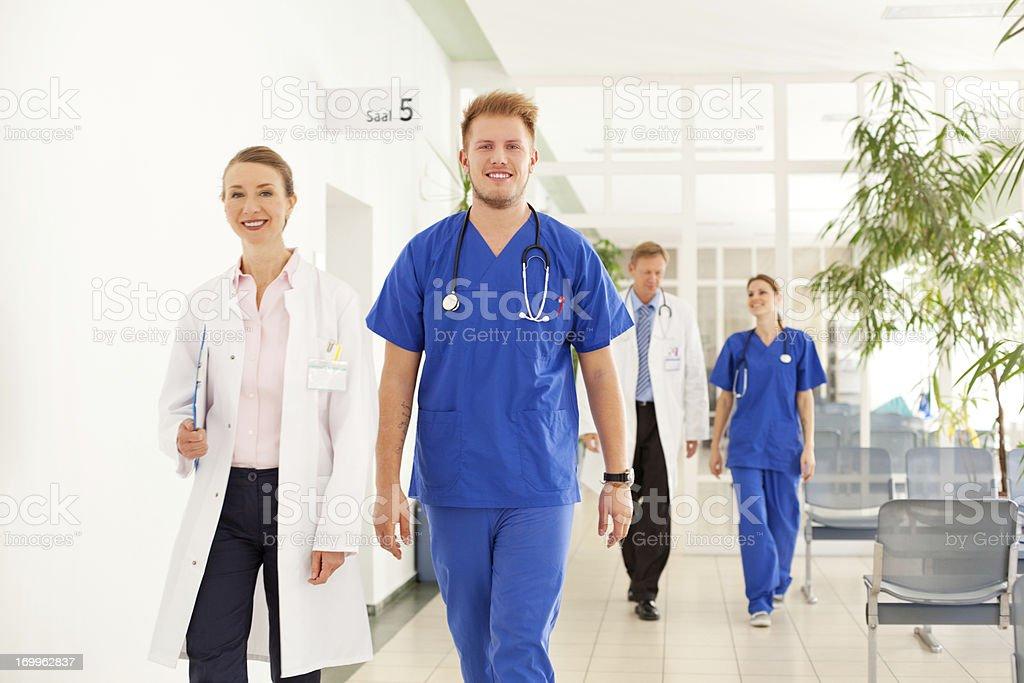 Doctors walking at the hospital stock photo