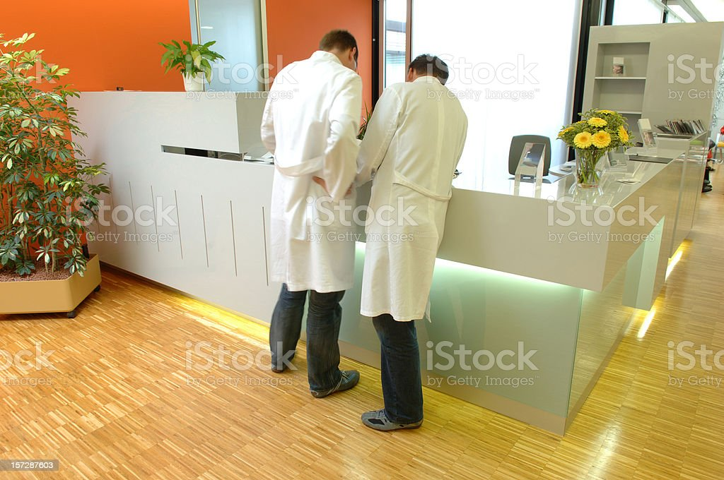 Doctors watching x-ray images stock photo