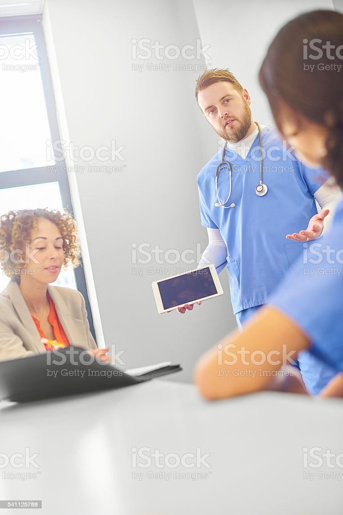 doctors with businesswoman stock photo